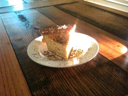 ricotta cheese tart on antique oak table made from re-purposed apple bins